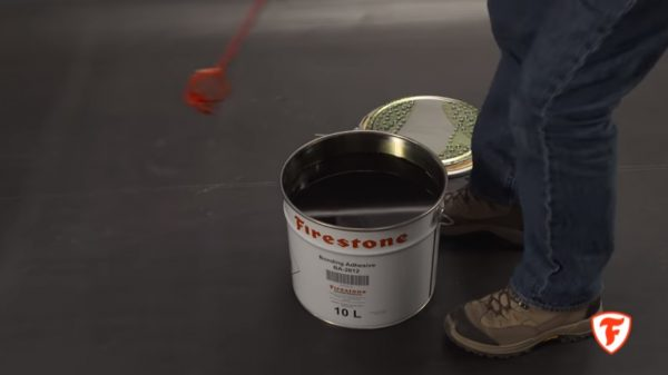 Firestone Bonding Adhesive being stirred for use on EPDM membrane