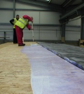 Firestone Water Based Adhesive being prepared on a model roof