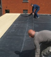 Firestone EPDM membrane being prepared on a roof