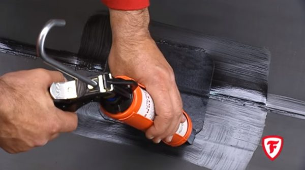 Firestone Lap Sealant being used on repair patch